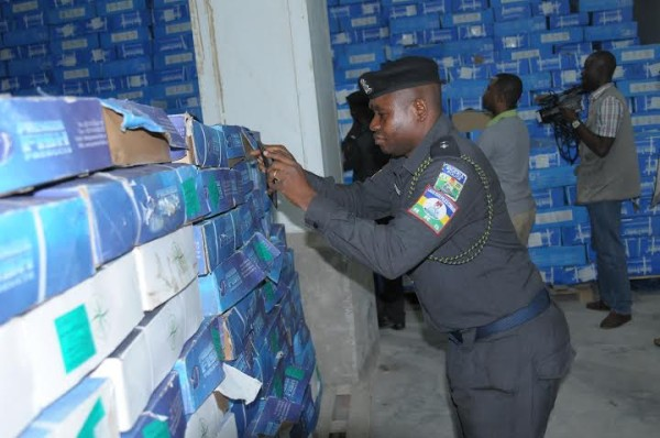 a police officer examines the cartons of fish
