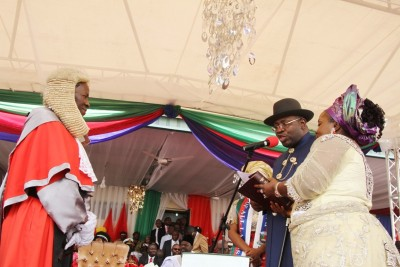 Chief Judge of Bayelsa State, Justice Kate Abiri (left), administering the oath of office on Gov. Seriake Dickson, (2nd right), ably supported by his wife, Rachael (right), during his swearing-in for a 2nd term as Governor of Bayelsa State at the Samson Siasia Sports Complex in Yenagoa. Photo by Lucky Francis