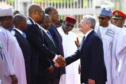 Here, the German President, Joachim Gauck, is being introduced to Buhari's team, comprising: Chief of Staff, Abba Kyari; Minister of Foreign Affairs, Geoffrey Onyeama; Minister of Justice, Abubakar Malami; Minister of Works, Housing and Power, Babatunde Fashola; Minister of Trade and Investment, Okechukwu Enemalah; National Security Adviser, Babagana Monguno and Minister of State for Power, Works and Housing Mustapha Baba Shehuri