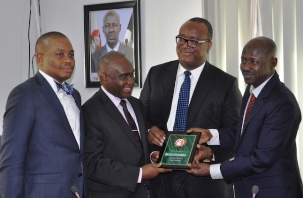 Magu, right, with Alegeh, second right and other NBA leaders in Abuja today