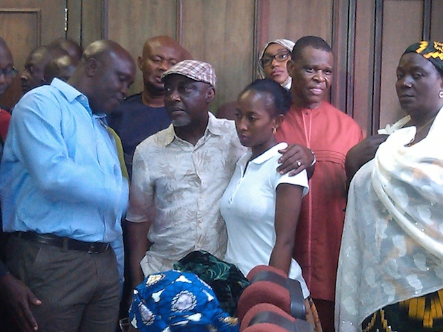 Moro, in cap, in court today, holding his daughter. Photo: Femi Ipaye