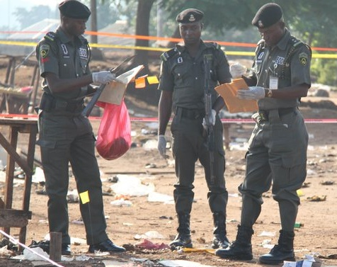 Nigerian bomb sqaud collects samples at a scene