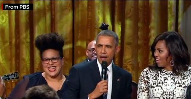 Obama with Michele, performing
