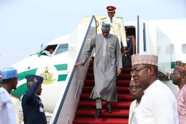 President Buhari disembarks from his aircraft on arrival in Abuja