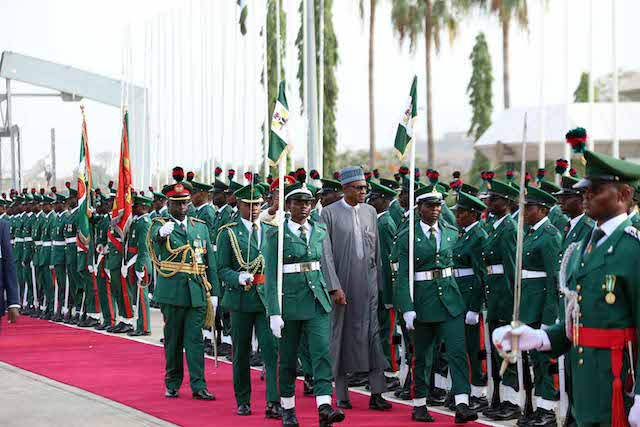 Buhari inspecting the Guards of honour on his Arrival from Qatar and Saudi Arabia