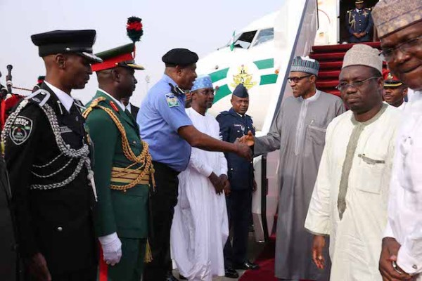 Police IG Solomon Arase was at the mouth of the plane ti welcome Buhari home