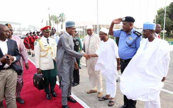 Governor, Ogbeni Rauf Aregbesola shakes hands with President Buhari