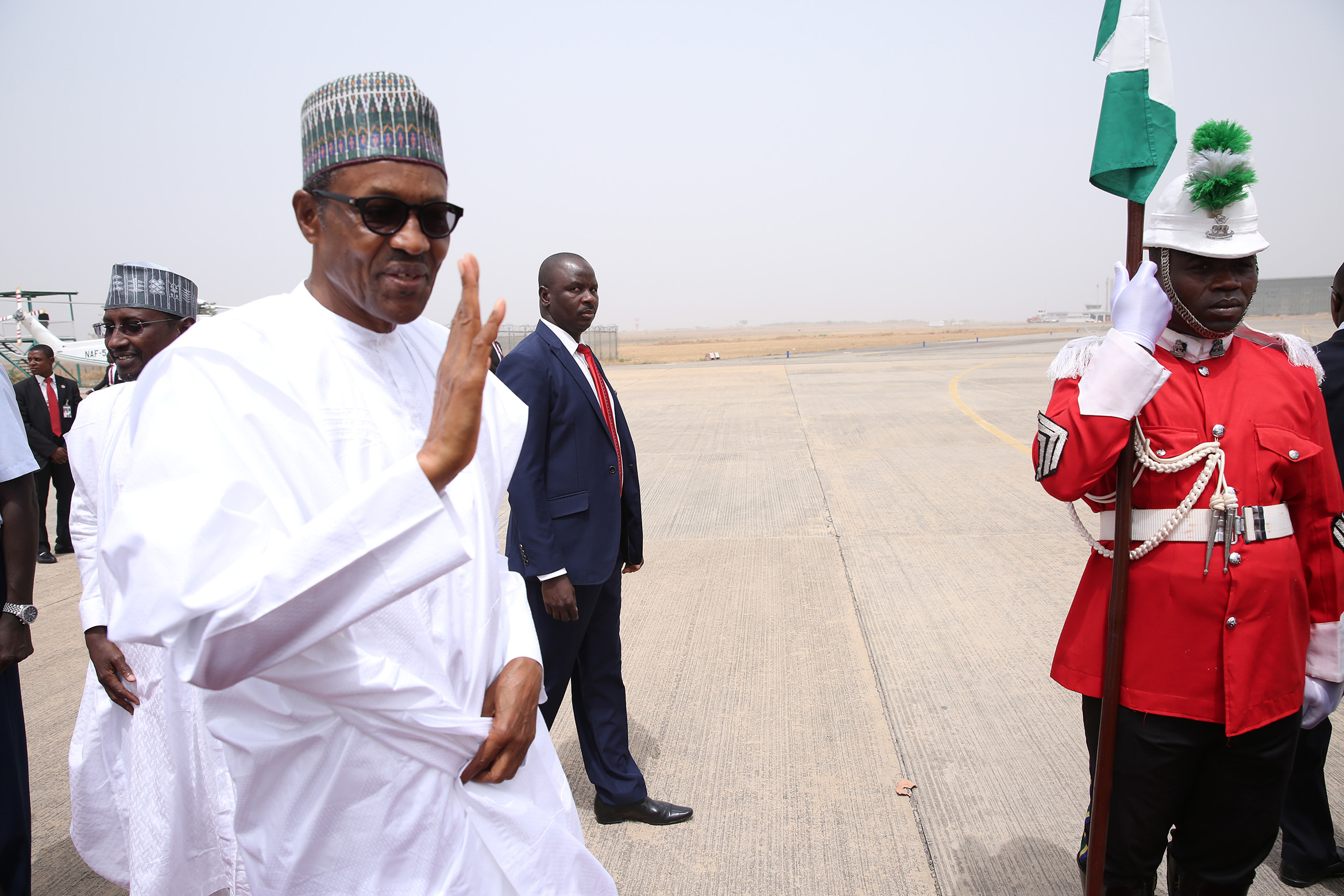 Buhari on the way to board the Presidential aircraft