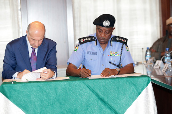 Inspector General Police, Mr Solomon Arase signing capacity building document with the Chief of Italian Police, Mr. Alessandro Pansa