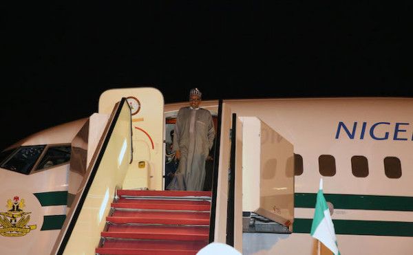 Buhari emerges from the aircraft