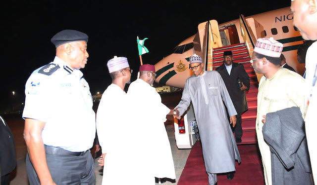 Chief of staff, Abba Kyari and others line up for a handshake
