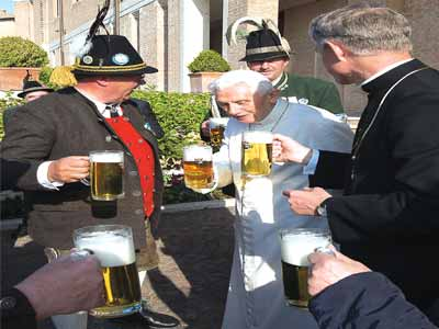 Retired Pope Benedict XV1(in white) flanked by friends during his 88th birthday. He celebrated the event with a party and a pint of beer