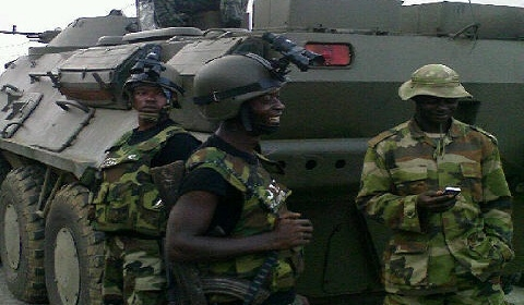 Nigerian soldiers with  a military tank. NAN Photo