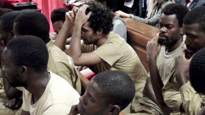 Luaty Beirao(hands over haed) with other activists  in court
