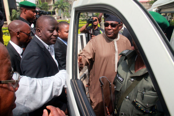 Alex Badeh entering the vehicle taking him to jail on Monday