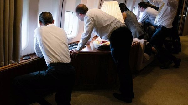 The Obamas and team having a glimpse of Havana inside Air Force One