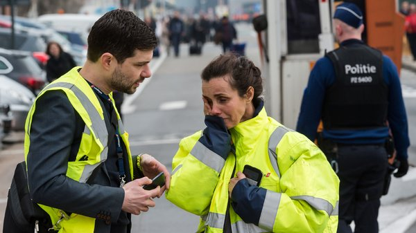 Belgium attack: a rescue worker being consoled