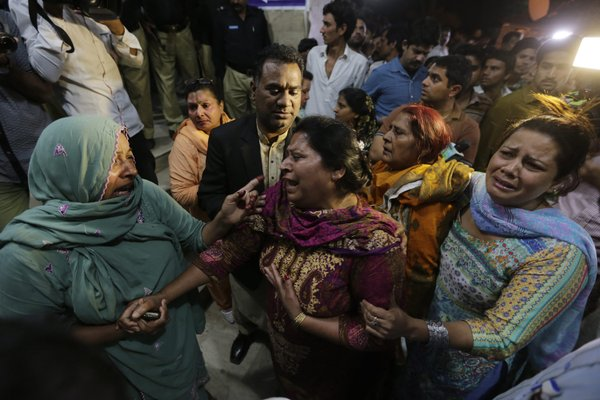 Lahore blast: a sobbing mom being consoled