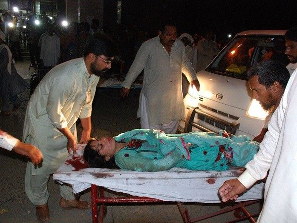rescue workers carry the injured