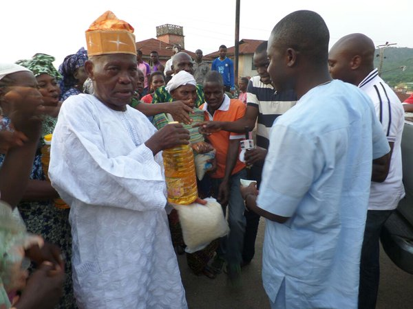 The handout state : an Ekiti man gets a litre of soya  oil, plus a sachet of rice