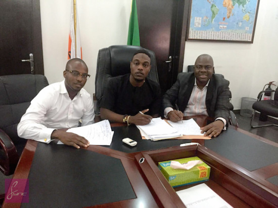 L-R (L.A.X New manager Ayo Odunsi, L.A.X. Lawyer during the contract signing