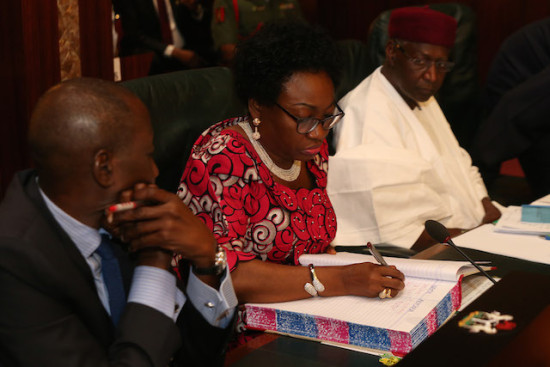 Another cabinet member fills the condolence register