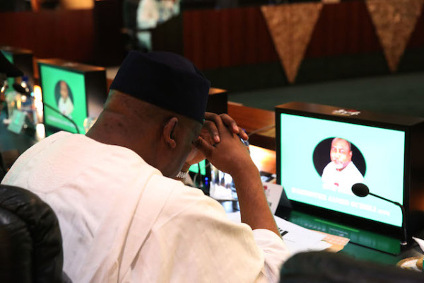 a cabinet member in  a sudued pose at the FEC meeting