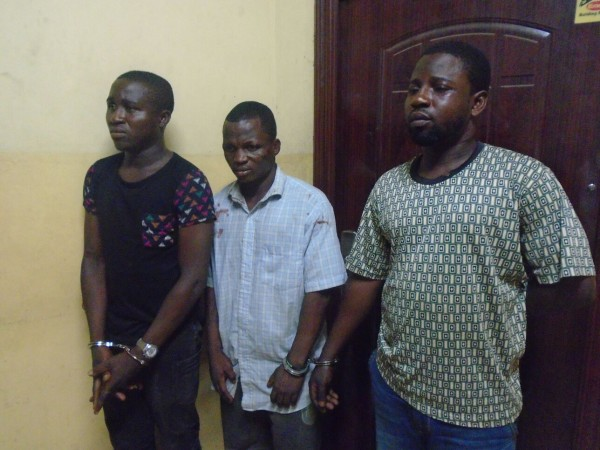 The phone thief, left and his 'receiving friends'