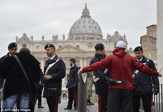 Policemen  check people at entrance of St Peter in Rome