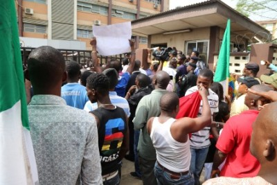 Some of the NLC members at the main entrance of Ikeja   Disco, locked out
