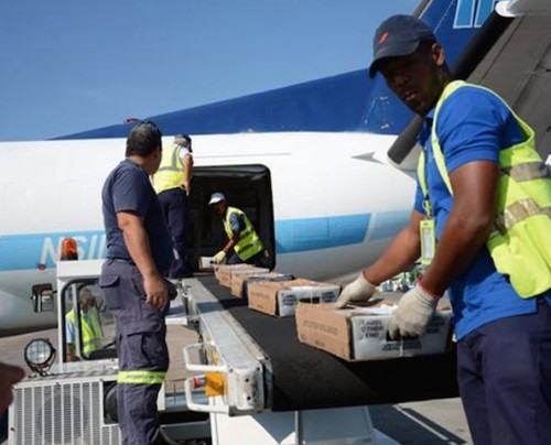 Mail from USA being discharged from plane