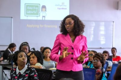 A female instructor teaches women the business know how