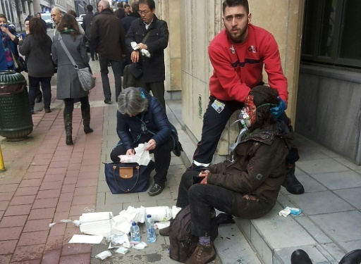 Brussels: a man helps an injured at train station