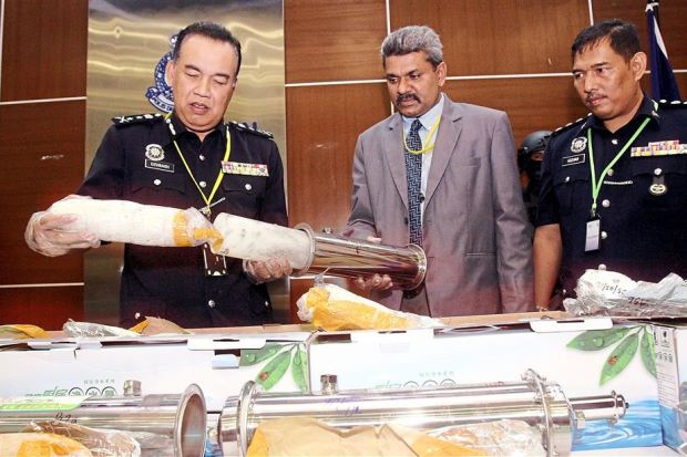 DCP Mohd Dzuraidi (left) showing the drugs seized during a press conference at the Bukit Aman police headquarters in Kuala Lumpur.