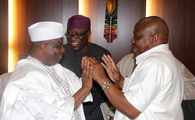 Wike and Tambuwal greet each other with Fayemi smiling