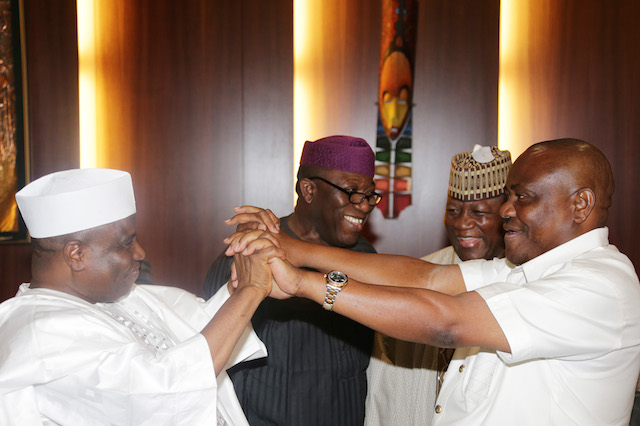 Tambuwal and Wike then lock hands  familiarly with Fayemi and Governor Yari joining in the drama