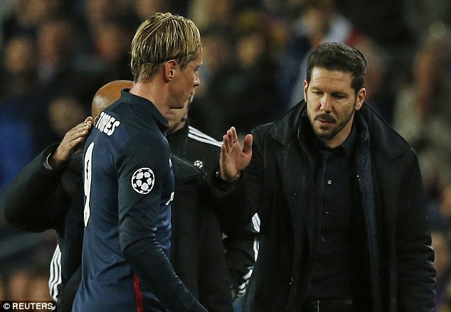Torres being greeted by Coach Simeone