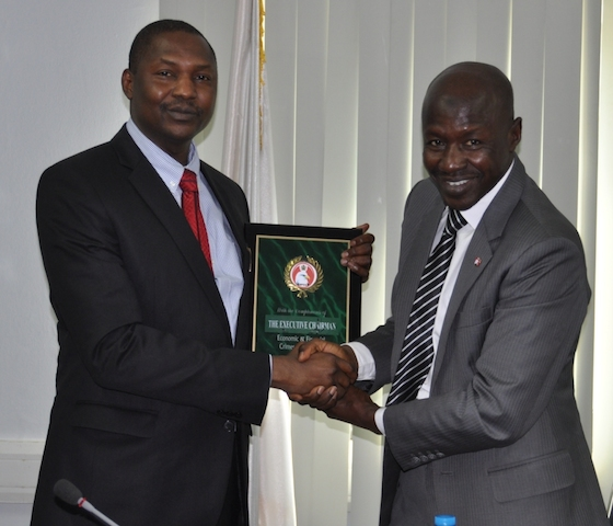 Malami receives a plaque from Magu