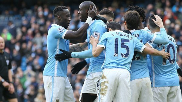 Yaya Toure with other City Players