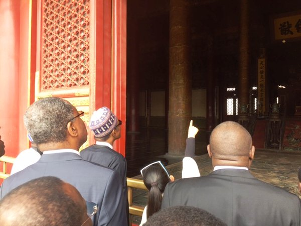 Geoffrey Onyeama, foreign minister, (left)standing behind President Buhari at Forbidden City