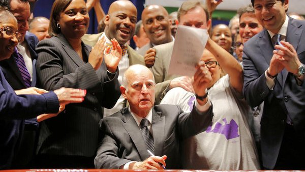 Governor Jerry Brown after signing the new minimum wage law