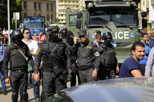 Egyptian policemen fire teargas at protesters