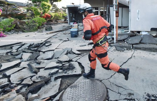 A rescue worker running to offer assistance