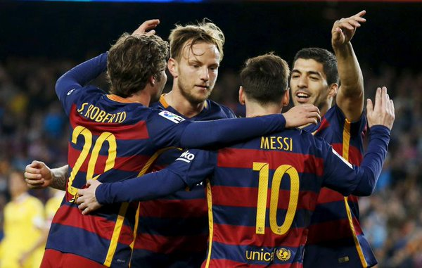 Luis Suarez and Messi with other team mates