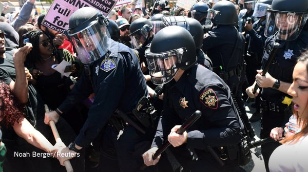 Police try to keep Trump protesters at bay