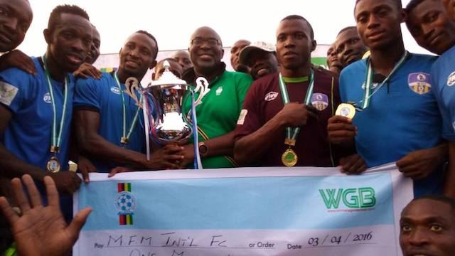 Chairman of Lagos FA with the MFM players and their trophy