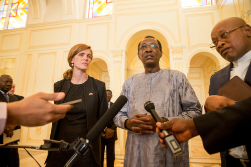Samantha Power, left, listens as Chad President Idriss Deby Itno, center, answers questions from members of the media