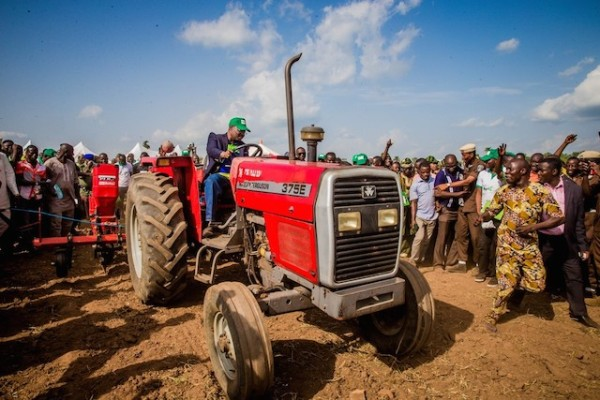 Governor Abiola Ajimobi driving a tractor at the launch of the agric programme