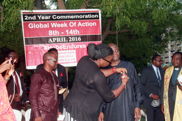 Mrs Shonibare decorating Pastor Tunde Bakare with BringBack ourGirls badge