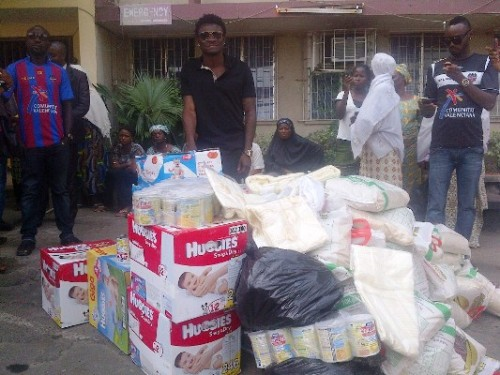 Obafemi Martins (middle) with some of the items donated to   the orphanage homes in Lagos